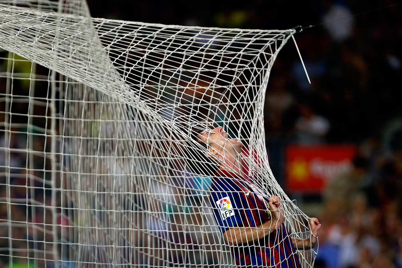Barcelona's Lionel Messi reacts after scoring against Osasuna during their La Liga match on Sept. 17, 2011 at the Camp Nou stadium in Barcelona, Spain.