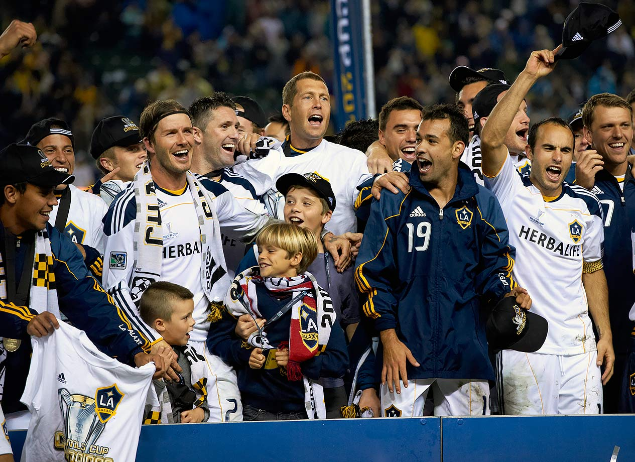 David Beckham celebrates with his sons Brooklyn, Romeo and Cruz, alongside teammates Juninho and Landon Donovan after the Los Angeles Galaxy defeated the Houston Dynamo in the 2011 MLS Cup at The Home Depot Center in Carson, Calif.