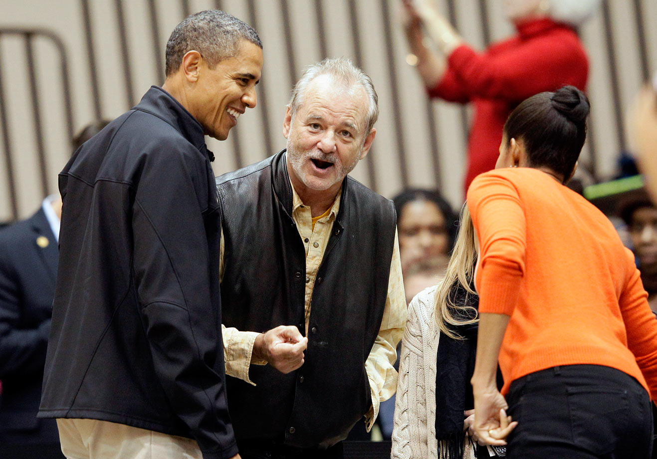 Bill Murray shares a laugh with President Barack Obama and First Lady Michelle Obama before an NCAA basketball game between Oregon State and Towson on Nov. 26, 2011 in Towson, Md.