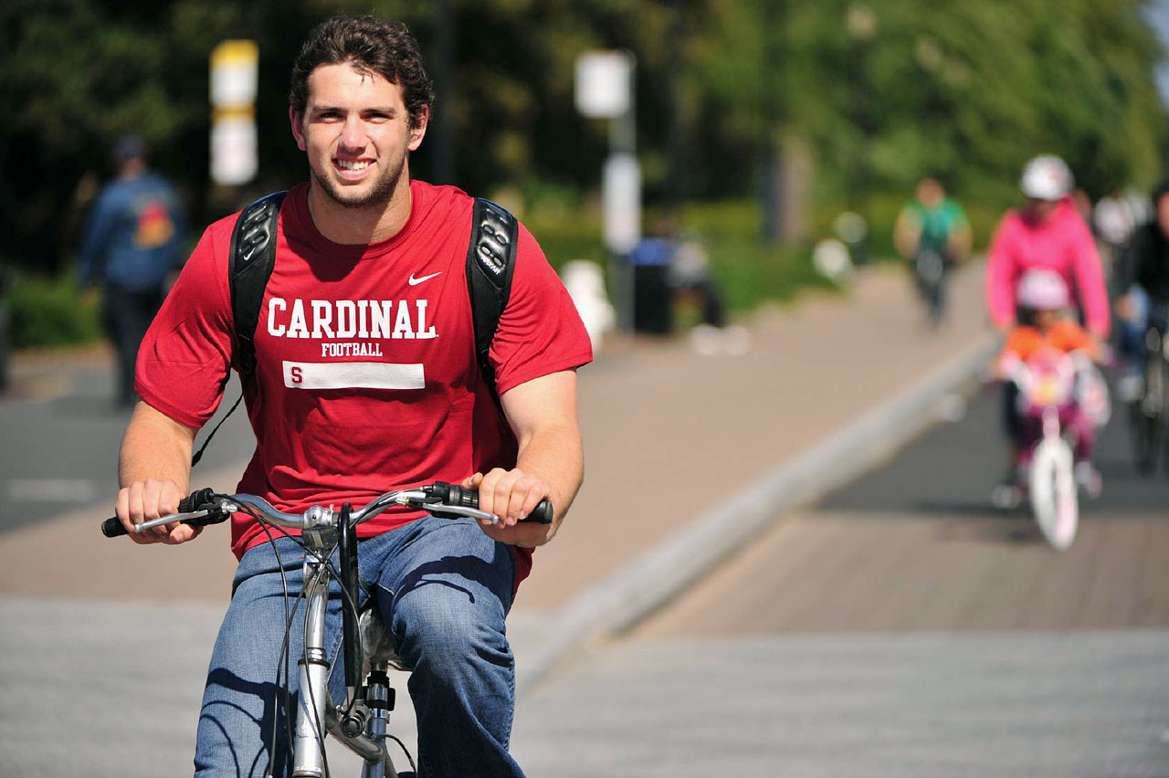 Andrew Luck rides his bike around the Stanford Campus on May 27, 2011.