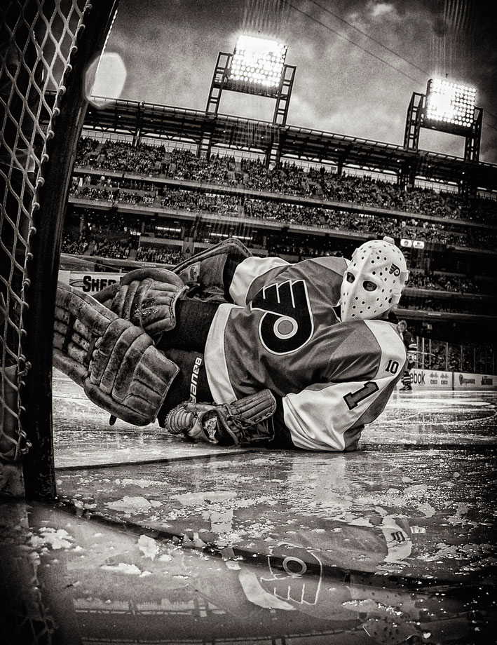Bernie Parent makes a save during the Alumni Game prior to the 2012 NHL Bridgestone Winter Classic at Citizens Bank Park on Dec. 31, 2011 in Philadelphia.