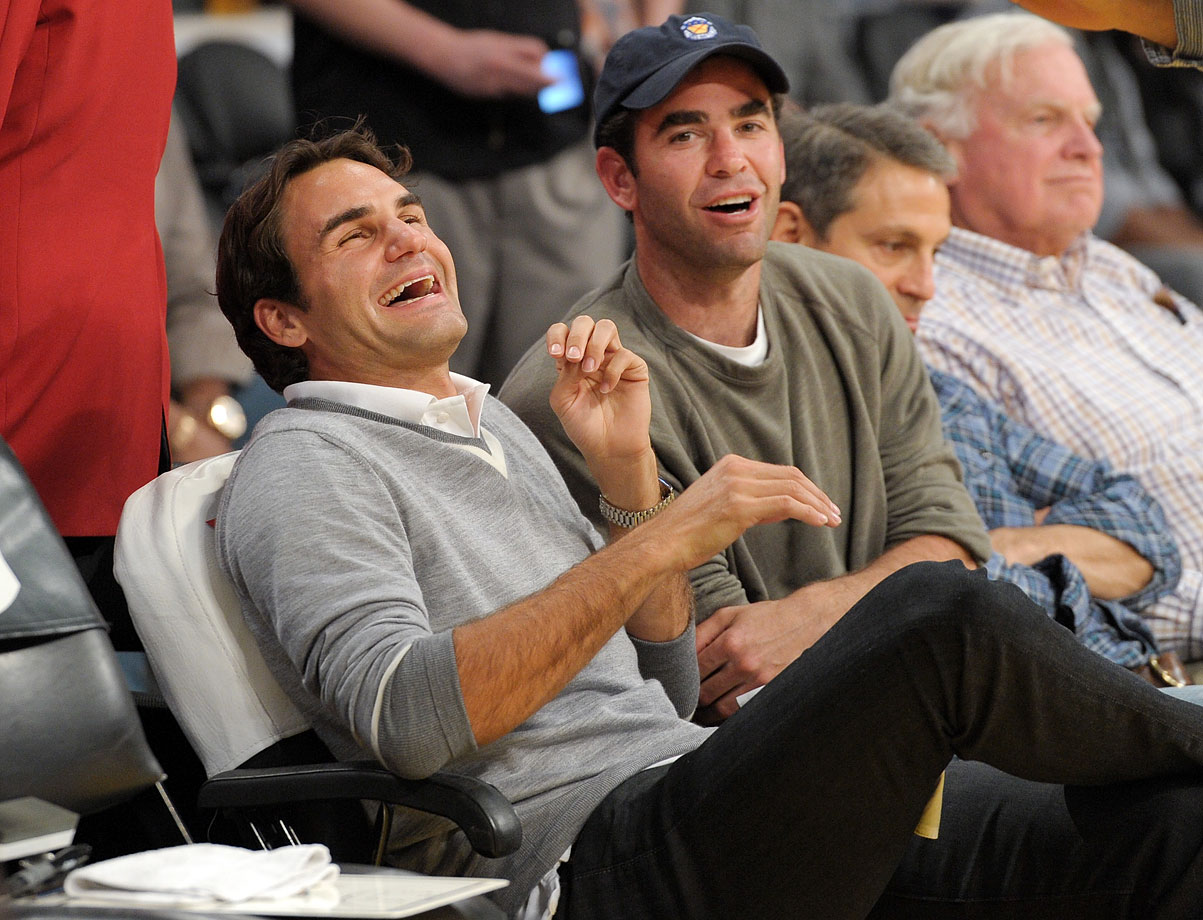 Roger Federer laughs with Pete Sampras as they attend a game between the Charlotte Bobcats and the Los Angeles Lakers at Staples Center in Los Angeles on March 4, 2011.