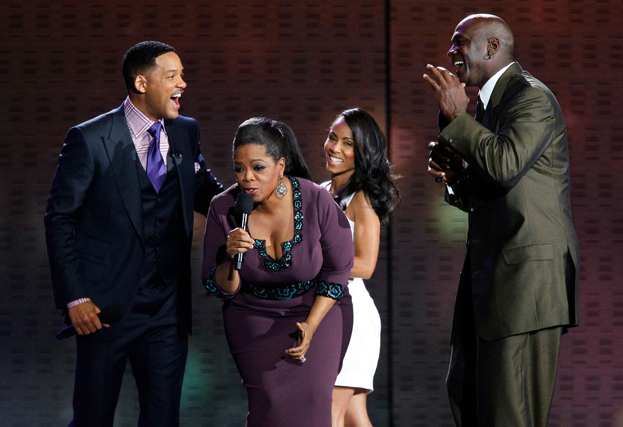 Oprah Winfrey reacts as she is surrounded by Will Smith, Jada Pinkett Smith and Michael Jordan during the taping of ''Surprise Oprah! A Farewell Spectacular'' in Chicago.