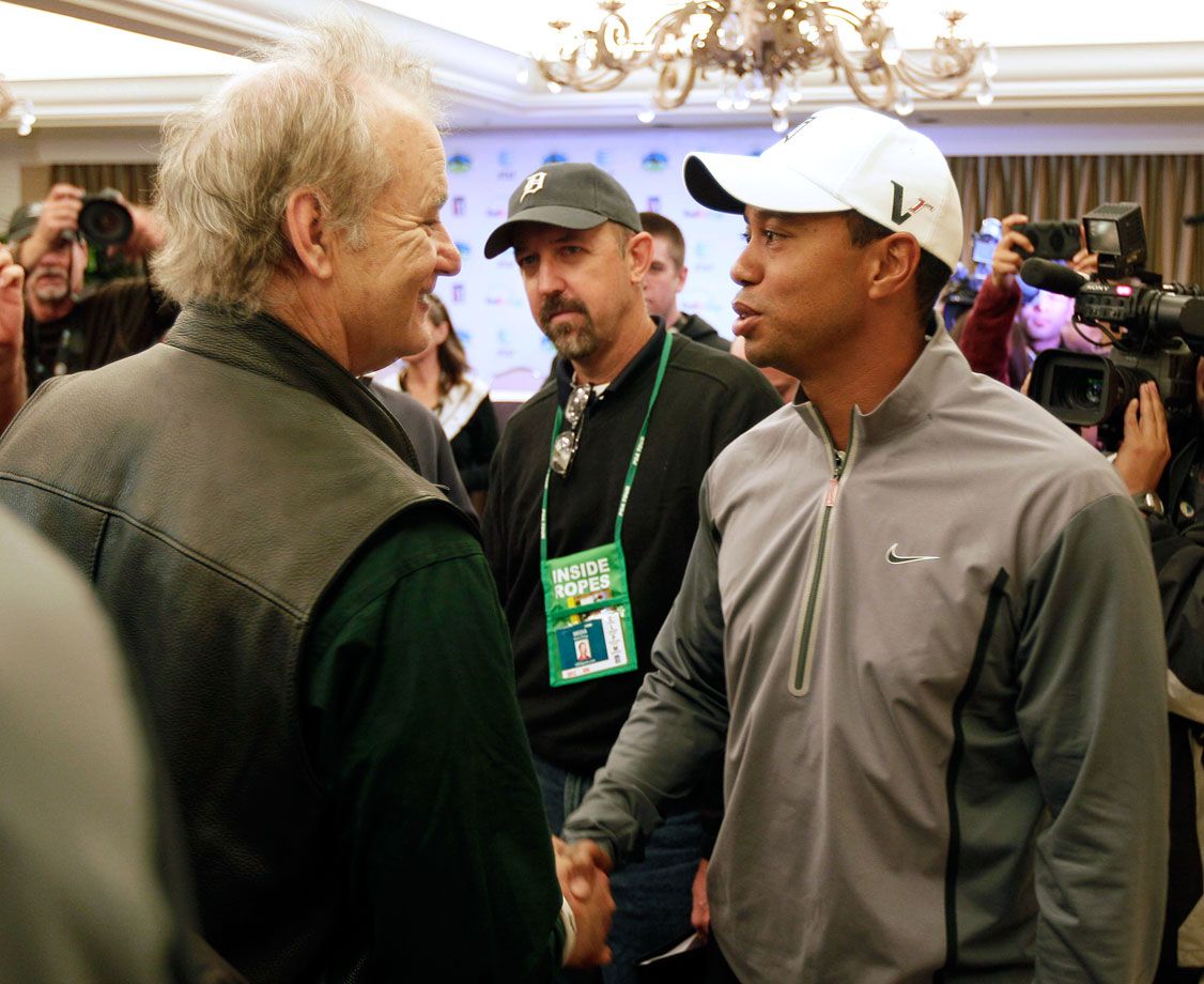 Tiger Woods greets Bill Murray after a news conference at the AT&T Pebble Beach National Pro-Am golf tournament on Feb. 7, 2012 in Pebble Beach, Calif.