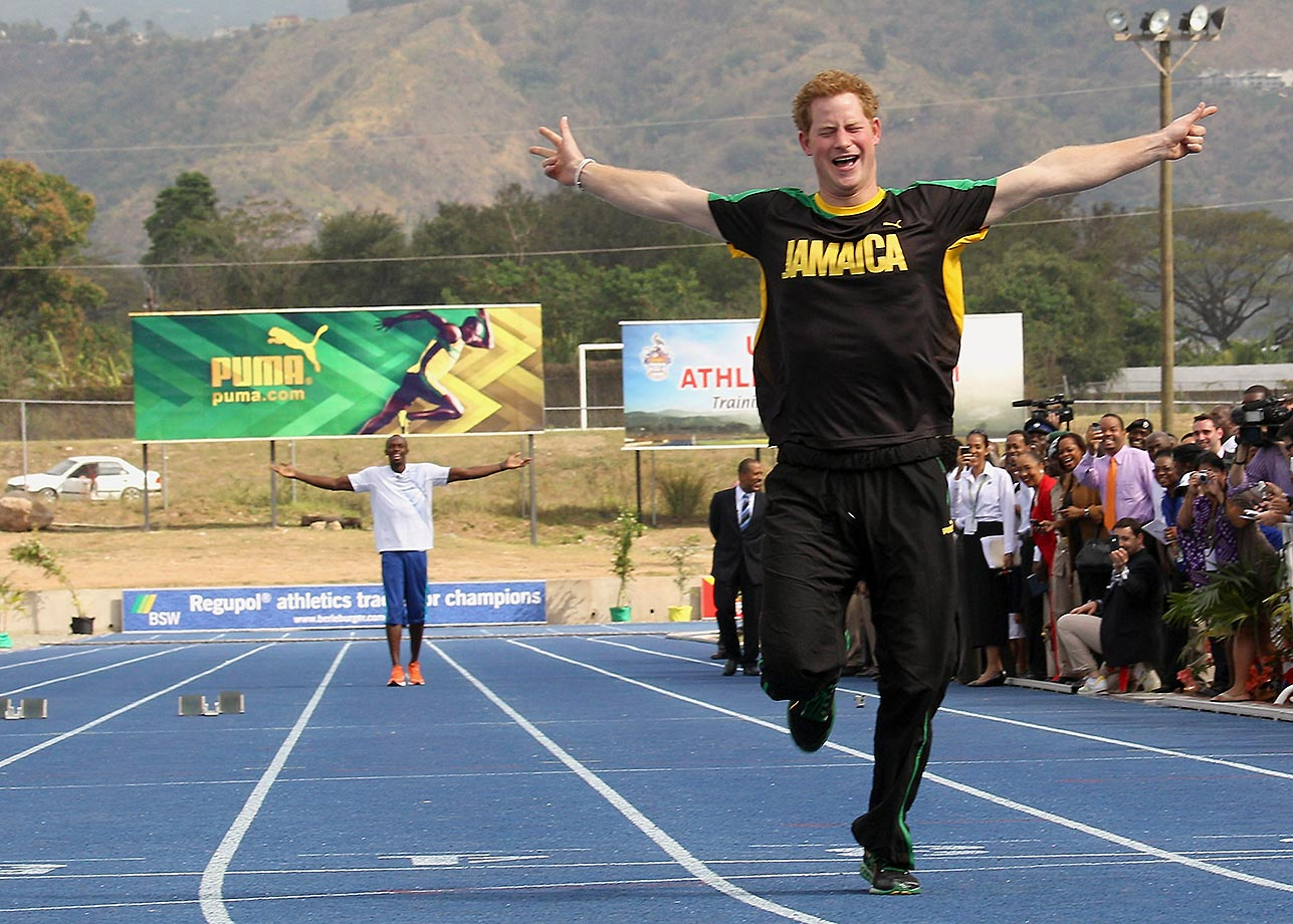 Prince Harry races ahead of Usain Bolt in 2012 at the Usain Bolt Track at the University of the West Indies in Kingston, Jamaica. Prince Harry was in Jamaica as part of a Diamond Jubilee Tour.