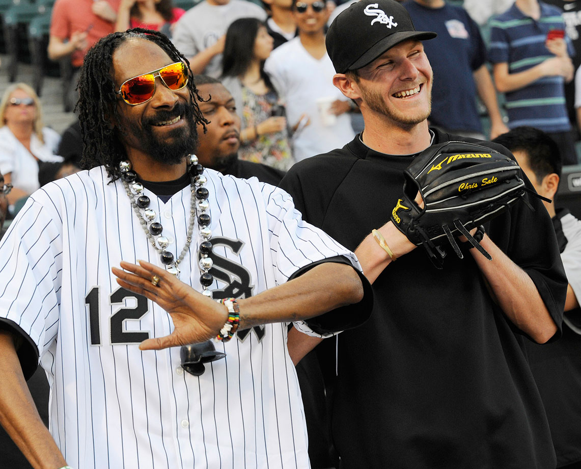 Snoop Dogg shares a laugh with pitcher Chris Sale before throwing out the first pitch for the Chicago White Sox game against the Minnesota Twins on May 24, 2012 at U.S. Cellular Field in Chicago.