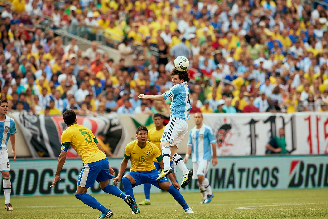 Argentina's Lionel Messi makes a header during an International Friendly against Brazil on June 9, 2012 at MetLife Stadium in East Rutherford, N.J.