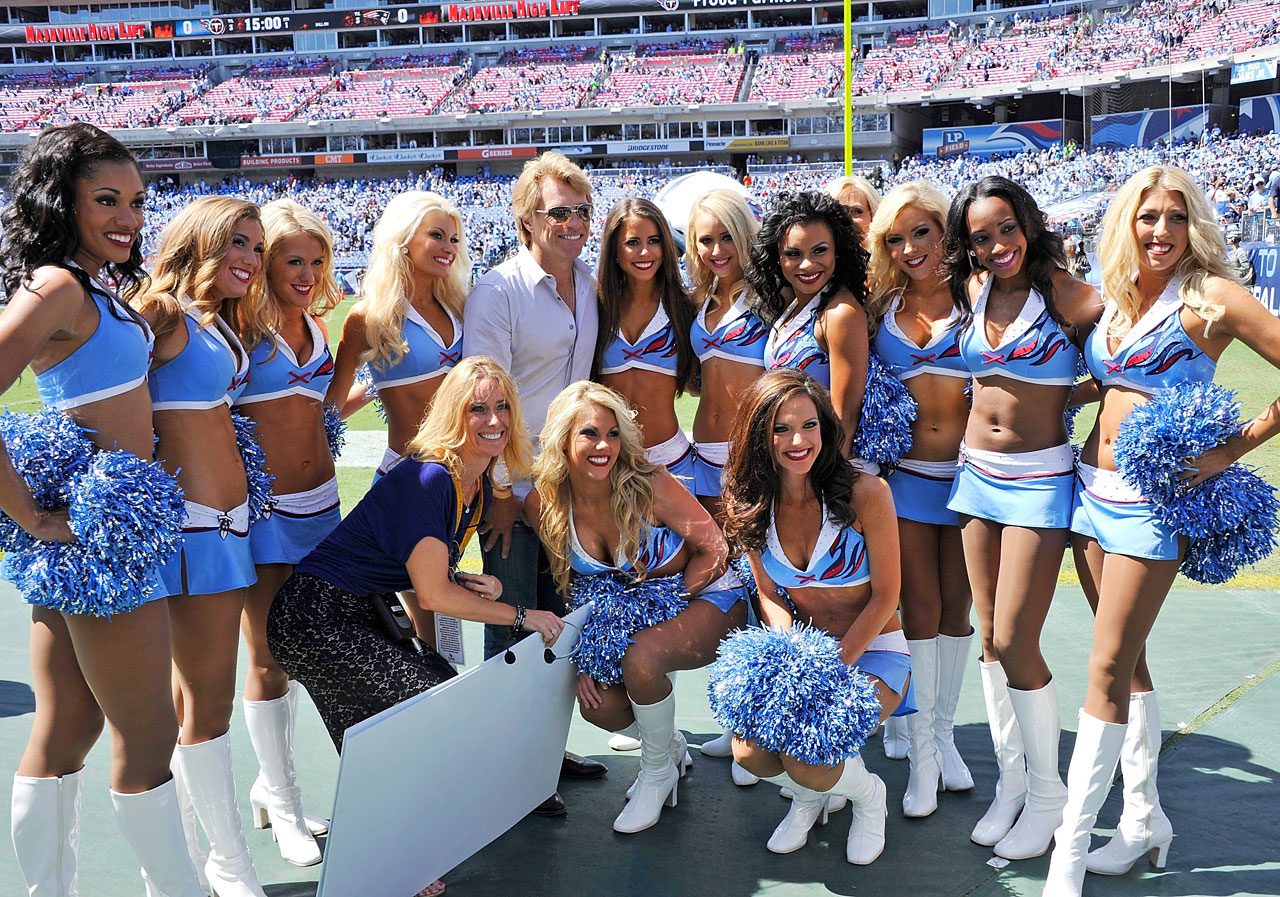 Jon Bon Jovi poses with the Tennessee Titans cheerleaders prior to a game against the New England Patriots during their season opener at LP Field in Nashville, Tenn.