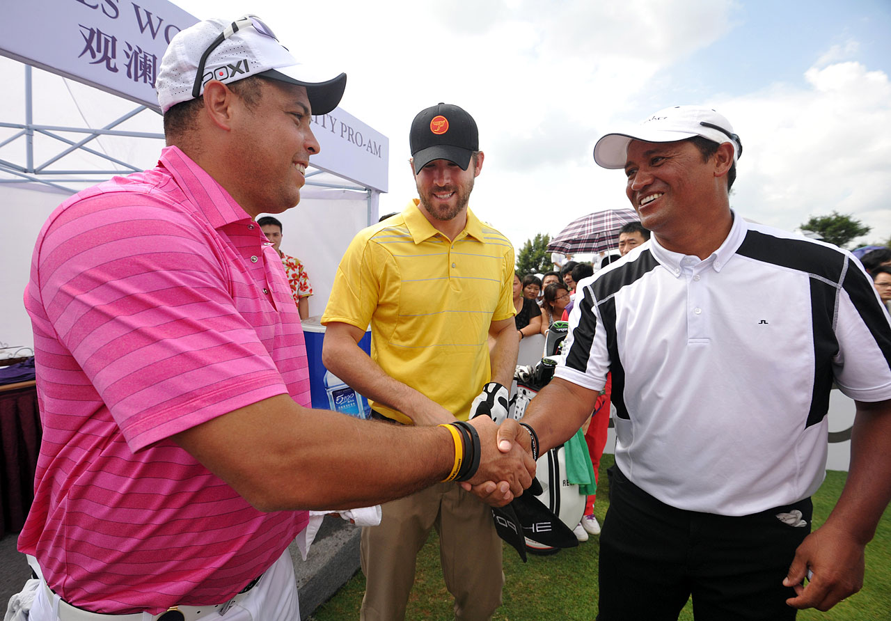 Ronaldo, Ryan Reynolds and Michael Campbell greet each other at the first hole on Day 3 of the World Celebrity Pro-Am at Mission Hills Resort on Oct. 20, 2012 in Haikou, China.
