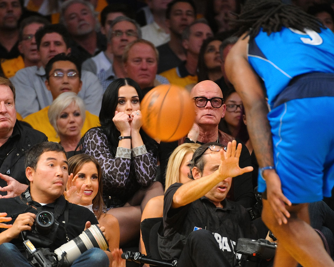 Katy Perry and her father, Keith Hudson, watch the Los Angeles Lakers game against the Dallas Mavericks at Staples Center Oct. 30, 2012 in Los Angeles.