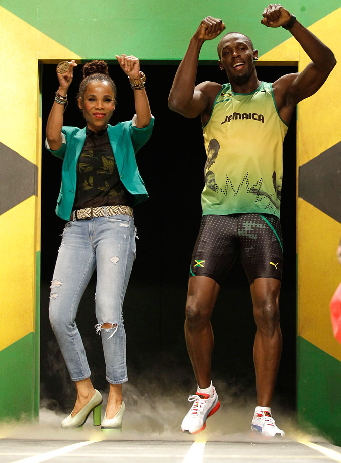 Usain Bolt models the Jamaican Olympic kit with designer Cedella Marley, daughter of Bob Marley, during the kit unveiling in London on June 1, 2012.