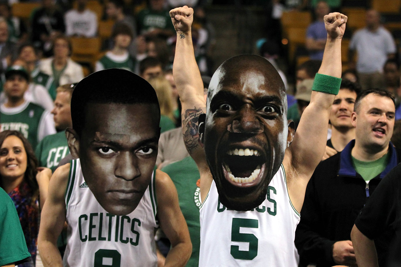 Fans wearing masks of Rajon Rondo and Kevin Garnett pose during Game 6 of the Eastern Conference Finals between the Celtics and Heat in Boston.