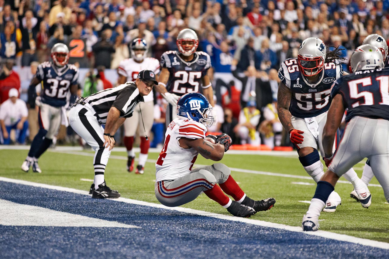 Giants back Ahmad Bradshaw scores with 57 seconds left in Super Bowl XLVI as he tried to stop himself from falling into the end zone to kill the clock.