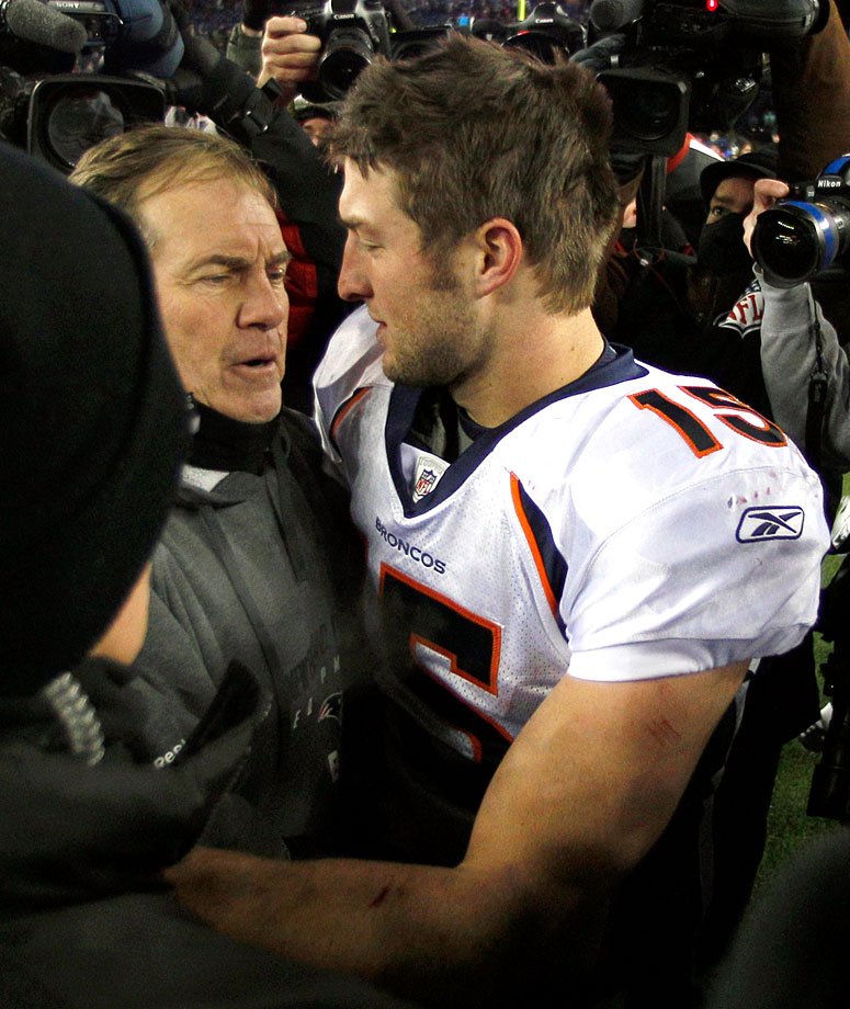 Tim Tebow hugs Pats head coach Bill Belichick following the Broncos divisional playoff loss.