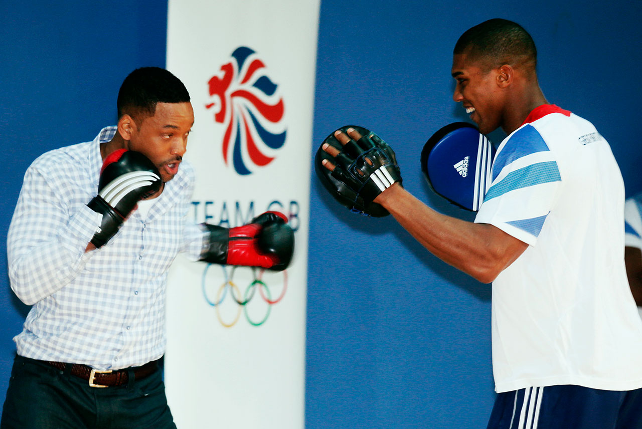 Will Smith boxes with Great Britain Olympic Super Heavyweight boxer Anthony Joshua at Ethos gym in London.
