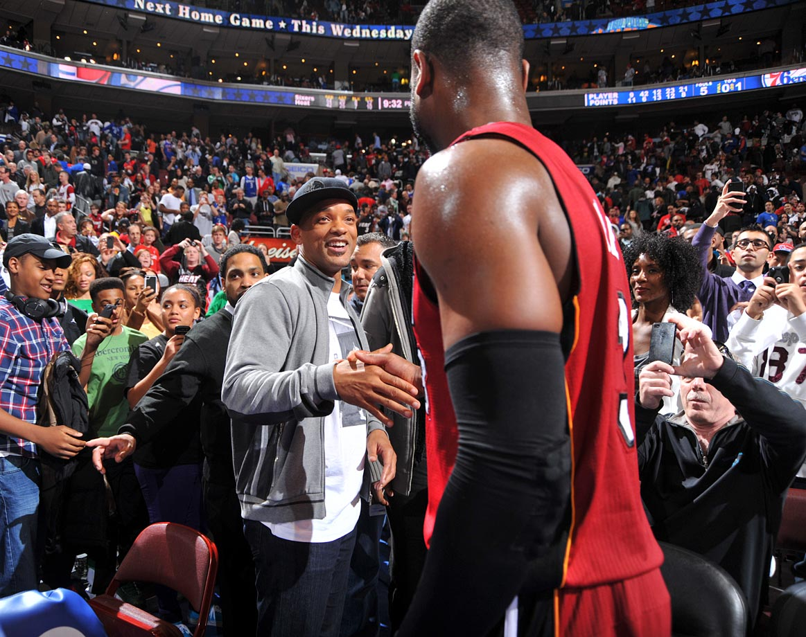 Will Smith shakes hands with  Dwyane Wade as he exits the court after the Heat defeated the 76ers at the Wells Fargo Center in Philadelphia.