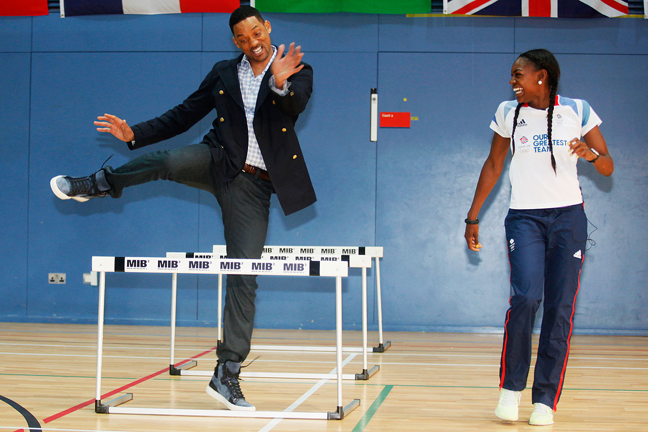 Will Smith tries the hurdles with Great Britain Olympic 400m hurdler Perri Shakes-Drayton at Ethos gym in London.