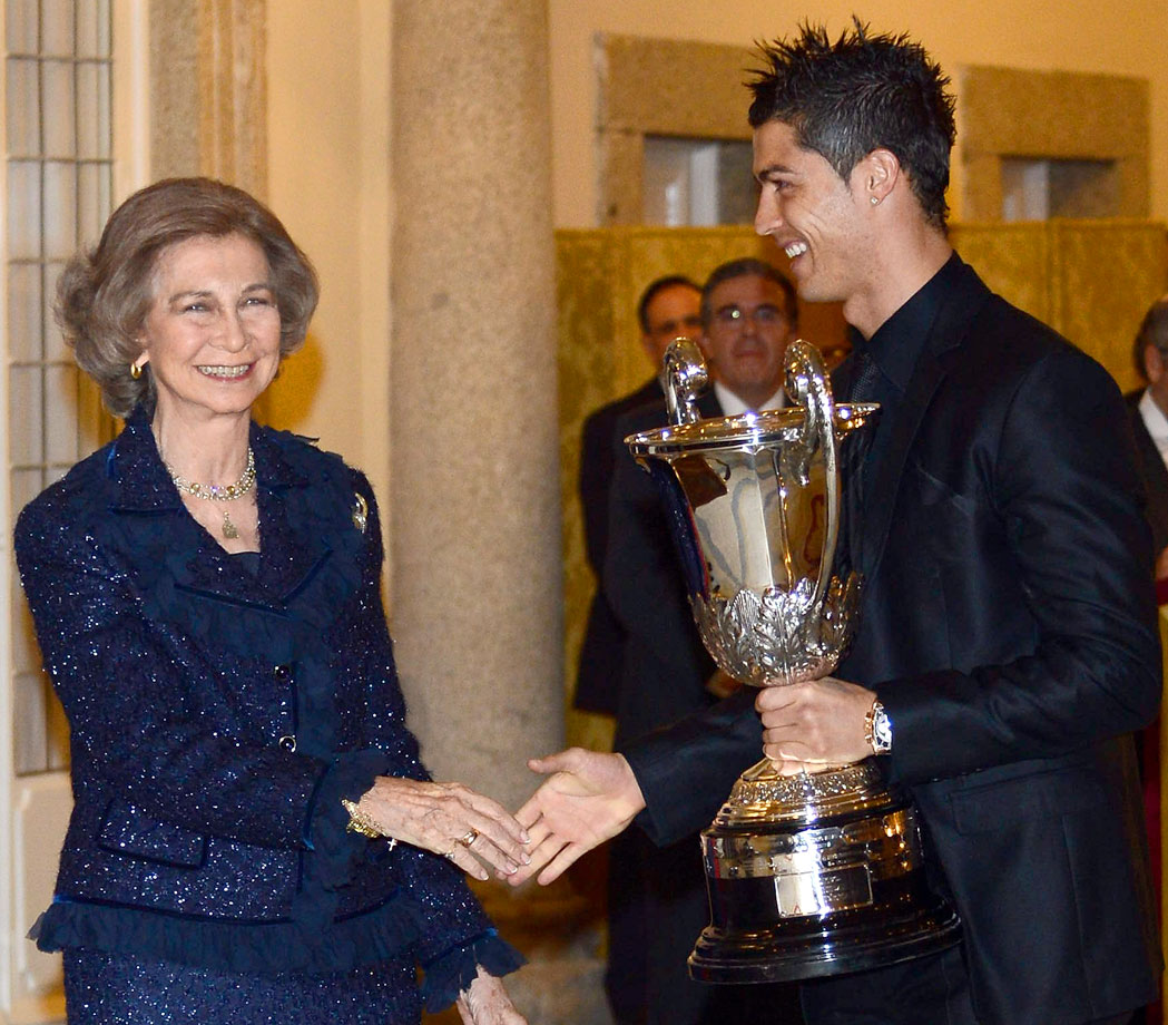 Queen Sofia of Spain presents Real Madrid's Cristiano Ronaldo with the Ibero-American Community Trophy during the National Sports Awards ceremony at El Pardo Palace in Madrid.