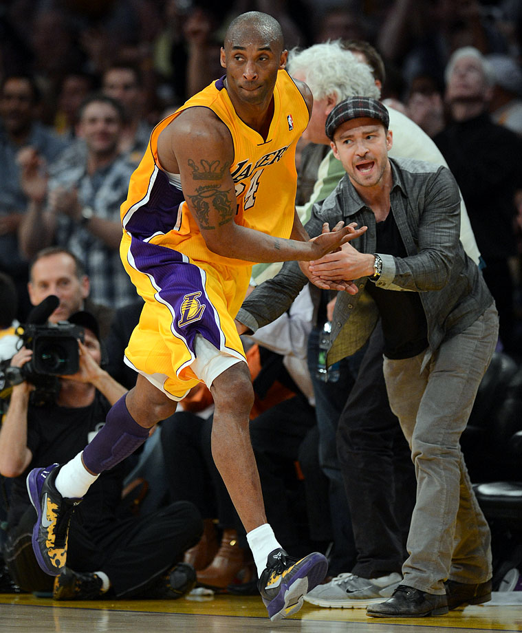 Justin Timberlake congratulates Kobe Bryant on making a basket in the fourth quarter against the Denver Nuggets in Game 7 of the NBA Western Conference Quarterfinals at Staples Center in Los Angeles on May 12, 2012.
