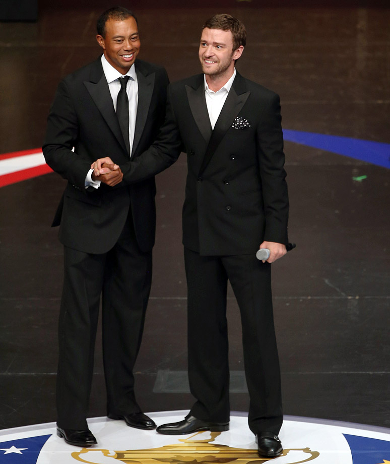 Tiger Woods talks with Justin Timberlake during the 39th Ryder Cup gala at Akoo Theatre in Rosemont, Ill., on Sept. 26, 2012.