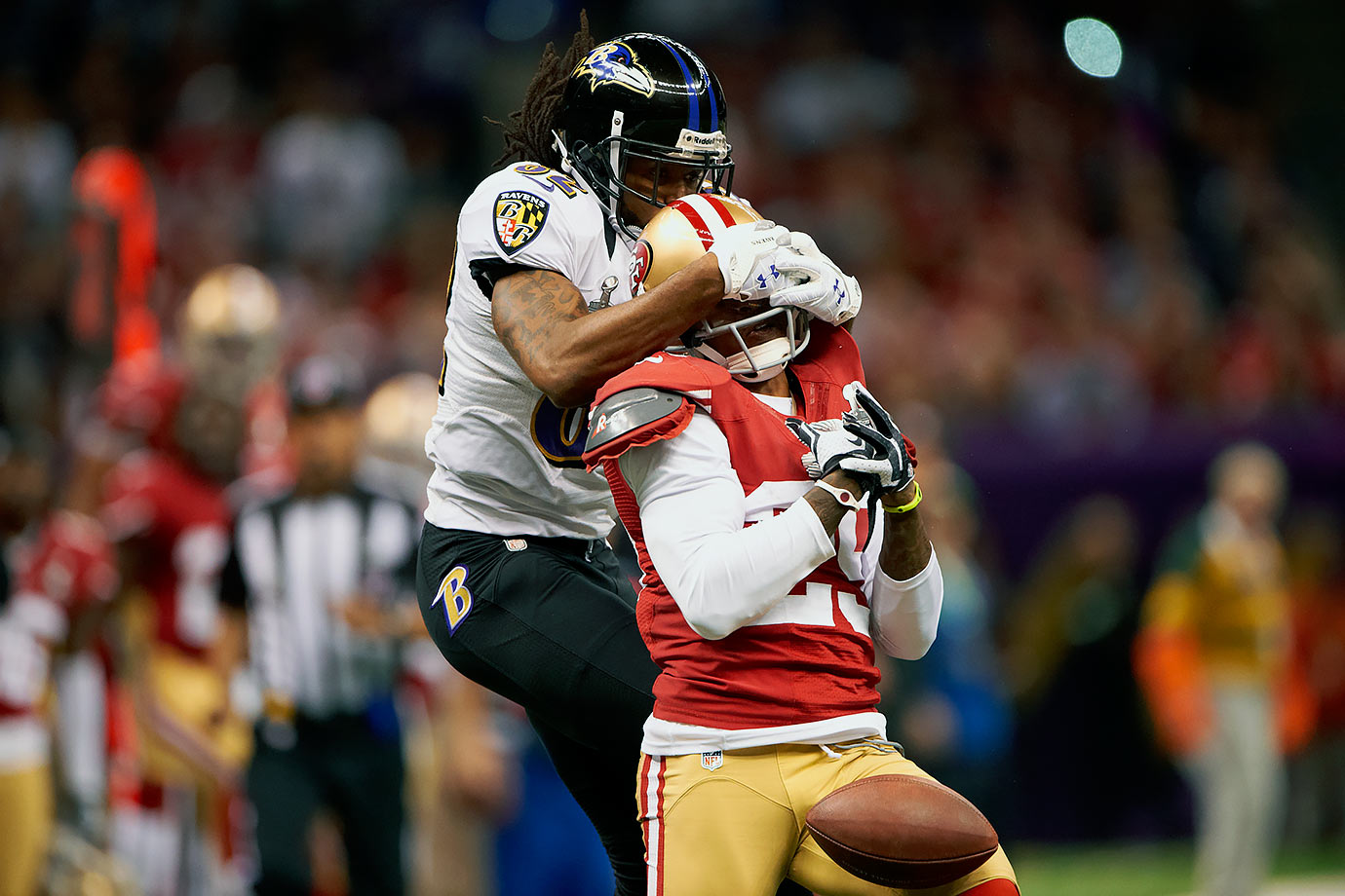 Baltimore Ravens wide receiver Torrey Smith turns into a defender to try to keep San Francisco 49ers cornerback Chris Culliver from making an interception. Ravens quarterback Joe Flacco's three touchdown passes and zero interceptions helped lead Baltimore to a 34-31 victory.