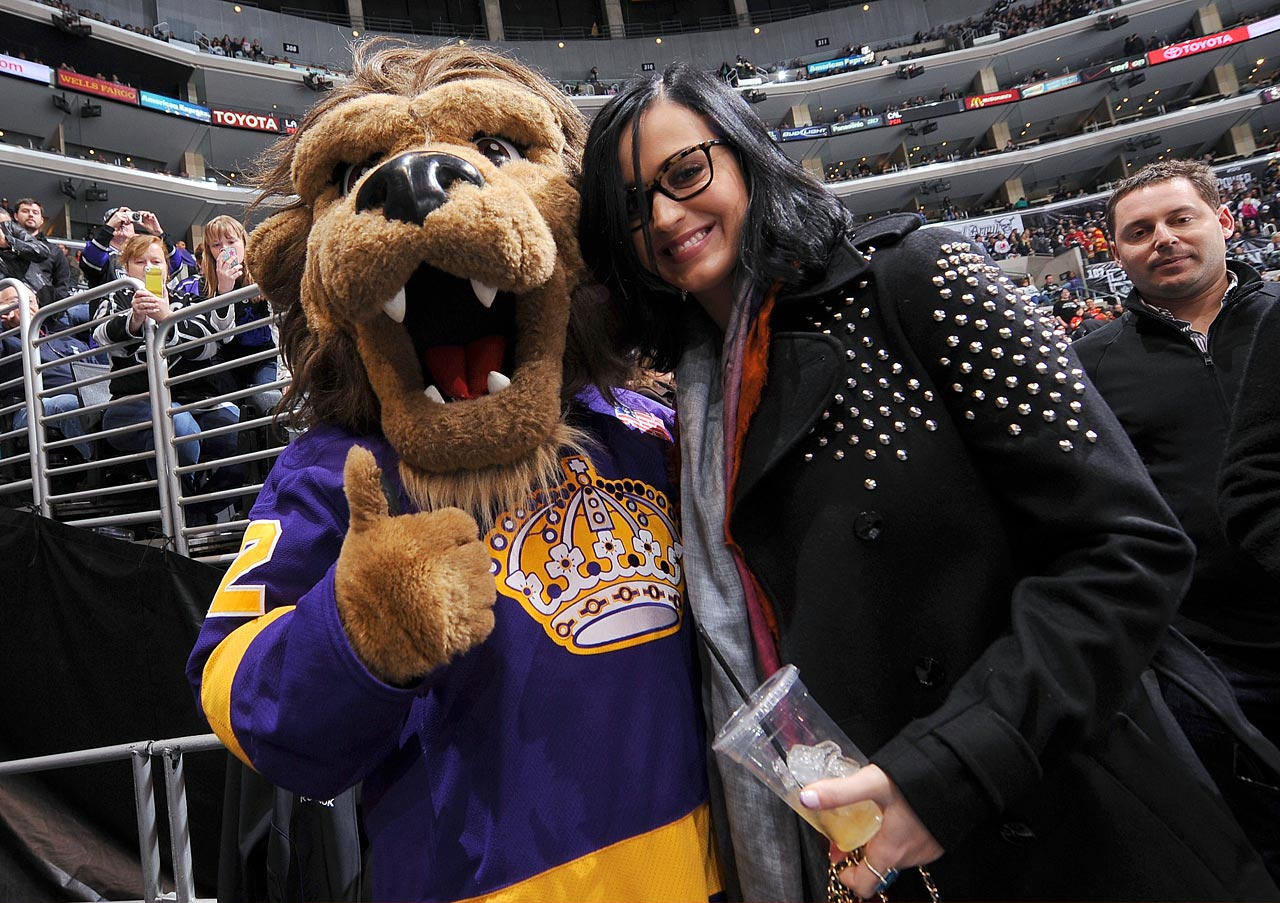 Katy Perry poses with the Los Angeles Kings mascot, Bailey, during the Kings game against the Calgary Flames at Staples Center on March 9, 2013 in Los Angeles.