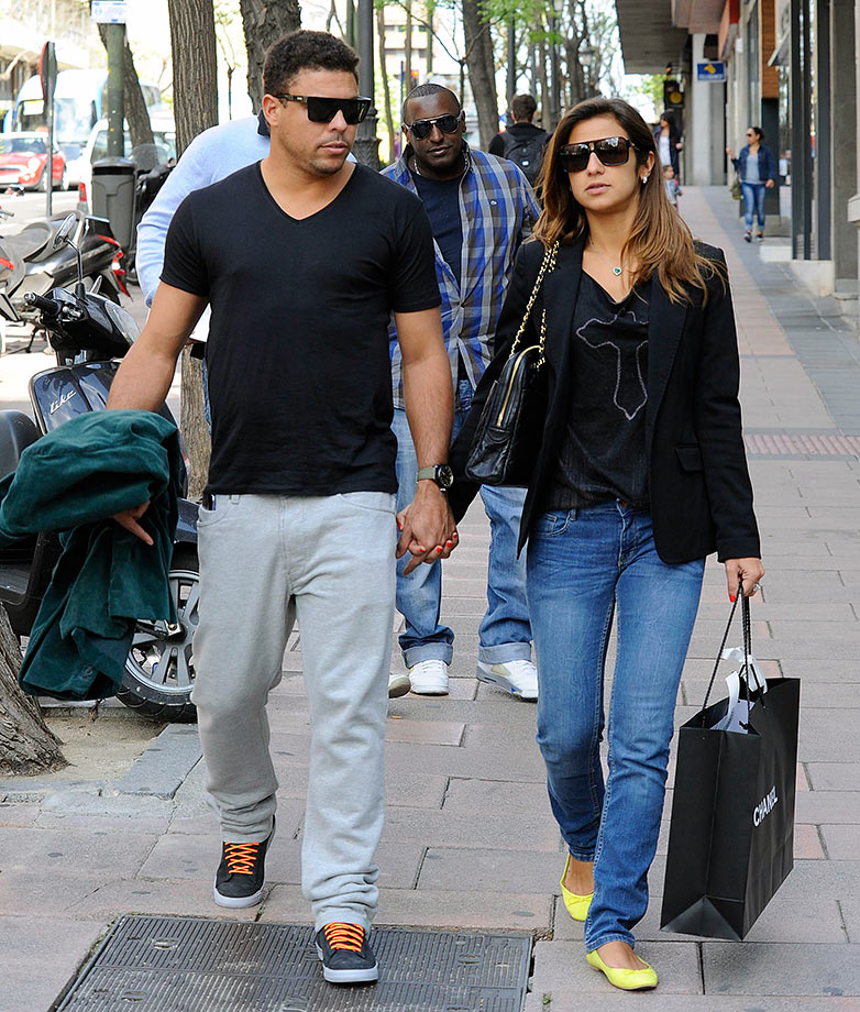 Ronaldo Nazario de Lima and then girlfriend Paula Morais walk along the streets of Madrid in 2013.