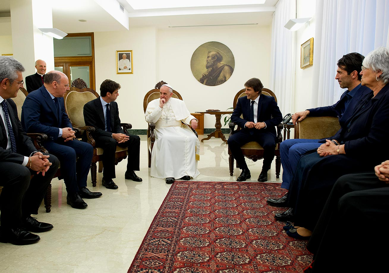 Pope Francis talks with Juventus team president Andrea Agnelli (left) and coach Antonio Conte (right) during their audience at The Vatican on May 21, 2013 in Vatican City.