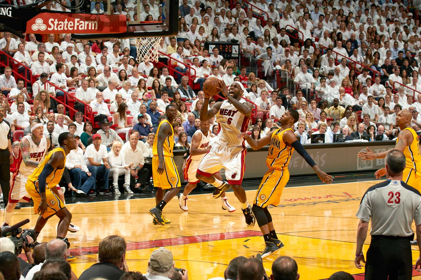 LeBron James capped off a triple-double (30 points, 10 assists, 10 rebounds) with a buzzer-beating, game-winning layup in overtime of Miami's 103-102 win over Indiana. James was the first player in NBA playoff history to record a triple-double and buzzer-beating game-winner in the same game.