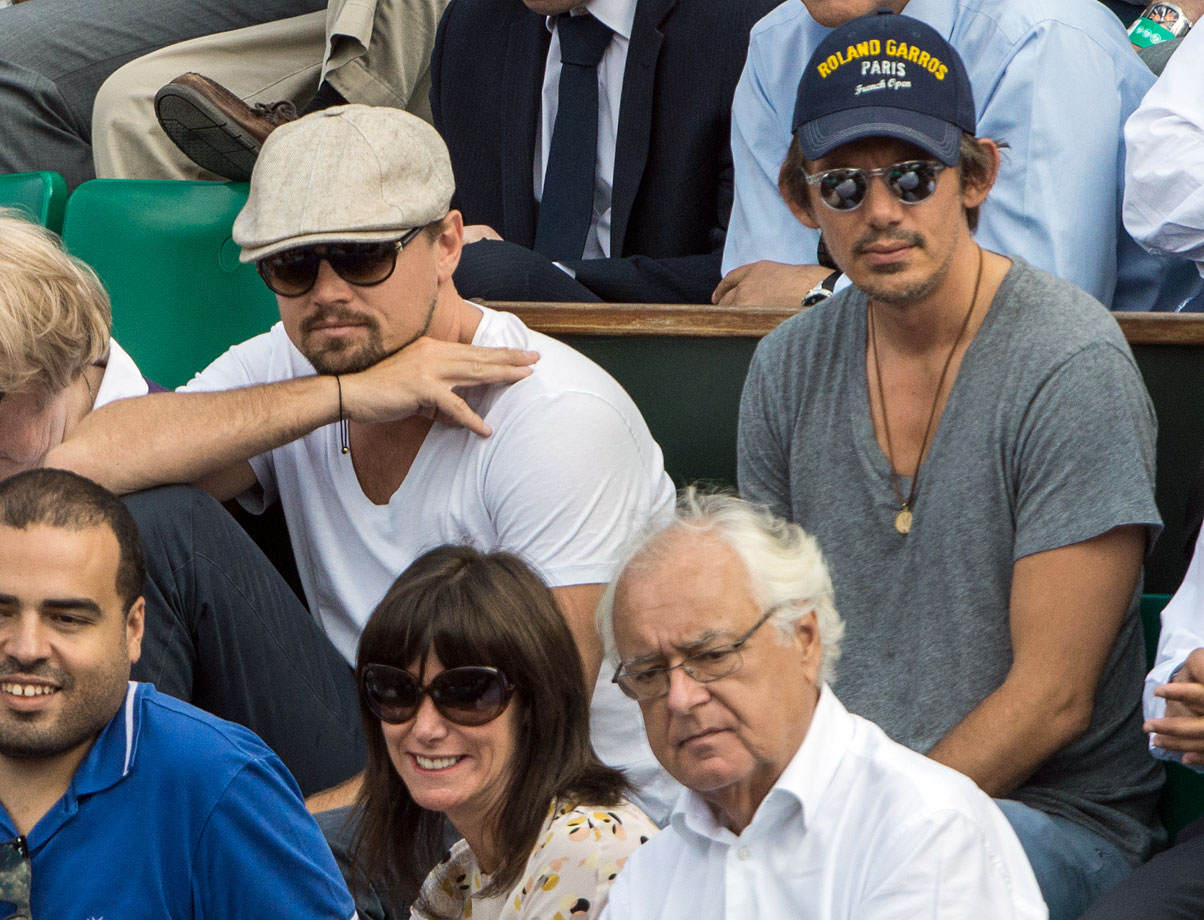 Leonardo DiCaprio and Lukas Haas attend the French Open at Roland Garros in Paris, France.