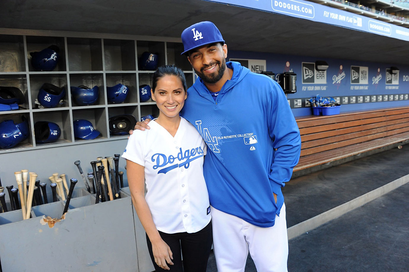 Olivia Munn poses with fellow Oklahoman Matt Kemp as she visits Dodger Stadium to throw the first pitch before the Dodgers game against the Arizona Diamondbacks on June 10, 2013 in Los Angeles.