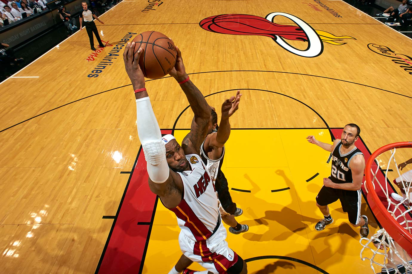 With the Heat facing elimination, LeBron James shook off a slow first half to score 16 fourth-quarter points, including a key three-pointer with 20 seconds remaining in regulation. He finished with his second triple-double of the 2013 Finals, tallying 32 points (on 11-for-26 shooting), 11 assists and 10 rebounds in the Heat's 103-100 OT victory over the Spurs.