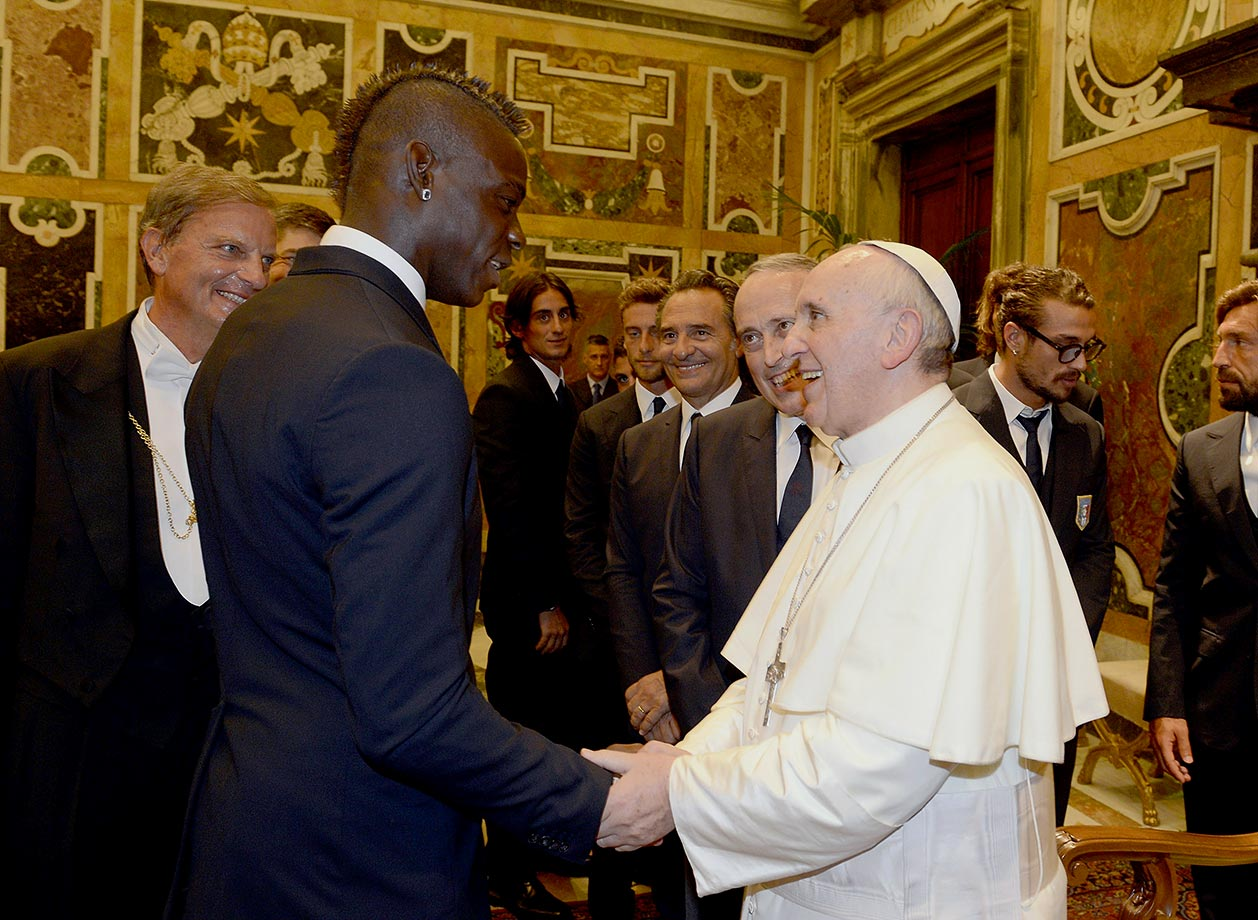 Mario Balotelli of Italy's national team shakes hands with Pope Francis during an audience at The Vatican on August 13, 2013 in Vatican City.