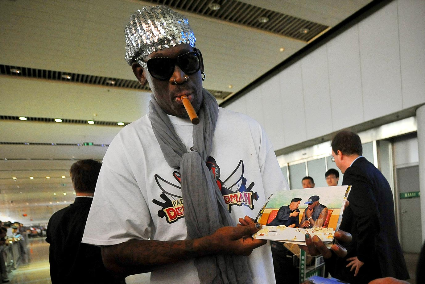 Rodman shows proof he was with his pal, Kim Jong-Un, upon his arrival at Beijing International Airport in 2013.