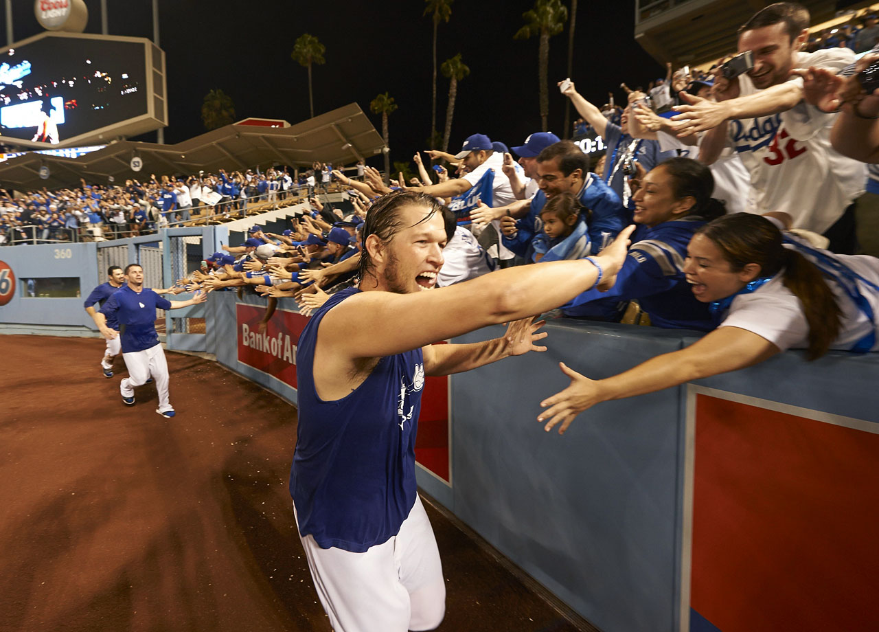 Clayton Kershaw celebrates with fans after winning Game 4 of the NLDS and the Dodgers' series against the Braves on Oct. 7, 2013 at Dodger Stadium in Los Angeles.