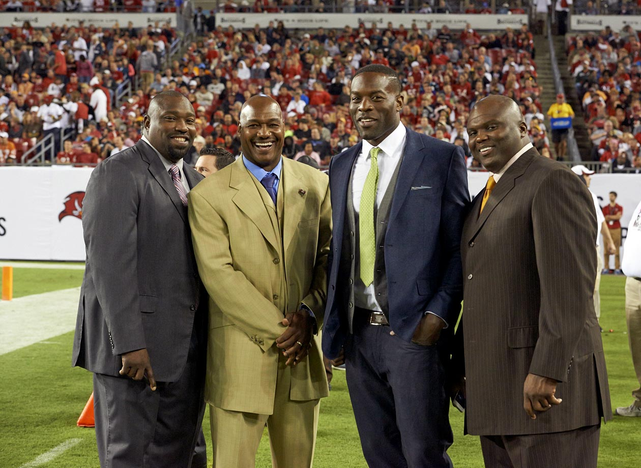 Former Bucs Warren Sapp, Derrick Brooks, Simeon Rice, and Anthony McFarland pose together on the sidelines before the Tampa Bay Buccaneers game against the Carolina Panthers at Raymond James Stadium on Oct. 24, 2013 in Tampa, Fla.