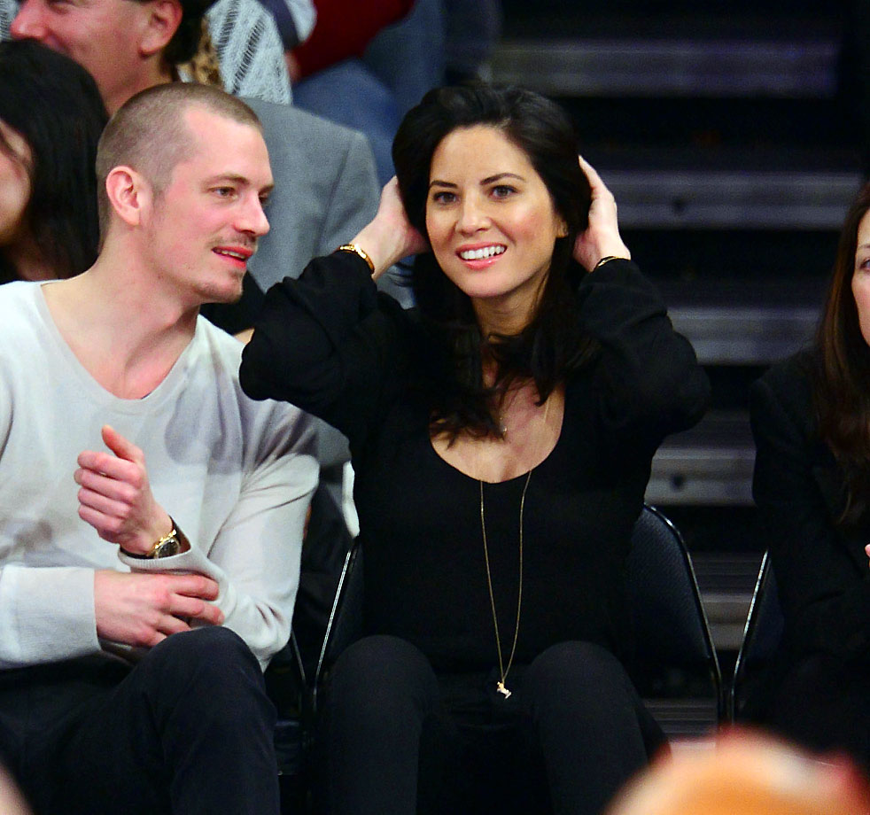 Olivia Munn and Joel Kinnaman attend the New York Knicks game against the Atlanta Hawks at Madison Square Garden on Dec. 14, 2013 in New York City.