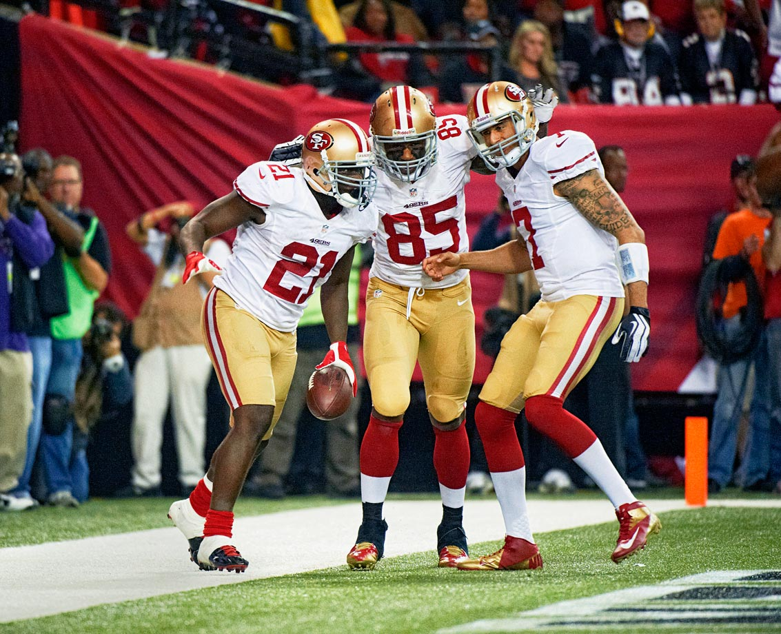 Frank Gore scored a pair of touchdowns, Vernon Davis hauled in five passes for 106 yards and a score, and Colin Kaepernick guided San Francisco on a pair of second-half scoring drives as the Niners overcame an early 17-0 deficit to beat the Falcons in Atlanta.