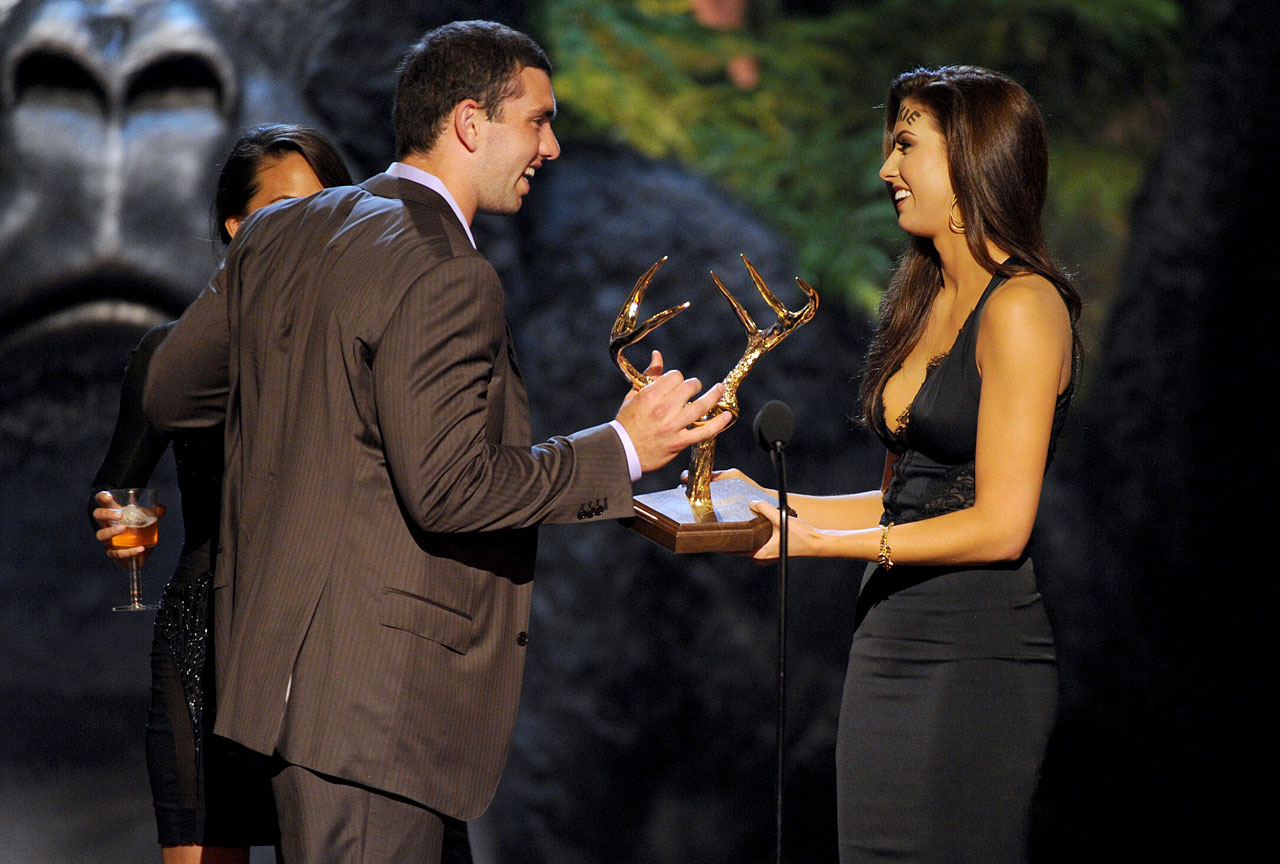 "Katherine Webb, with ''Rookie"" written across her forehead, presents the Spike TV's Guys Choice Award for Rookie of the Year to Andrew Luck on June 8, 2013 at Sony Pictures Studios in Culver City, Calif."