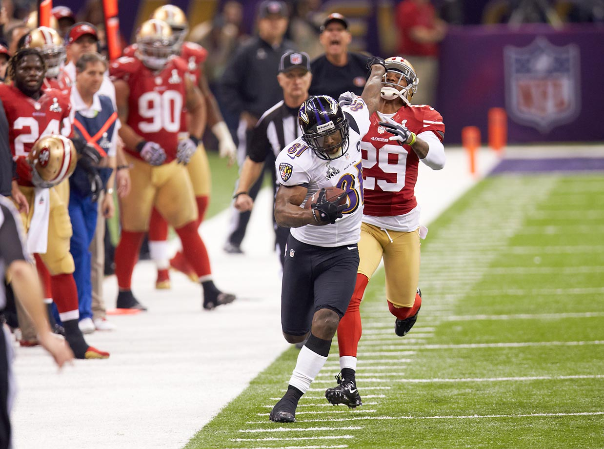 Anquan Boldin fends off Chris Culliver in a game that was delayed for 34 minutes by a power blackout.