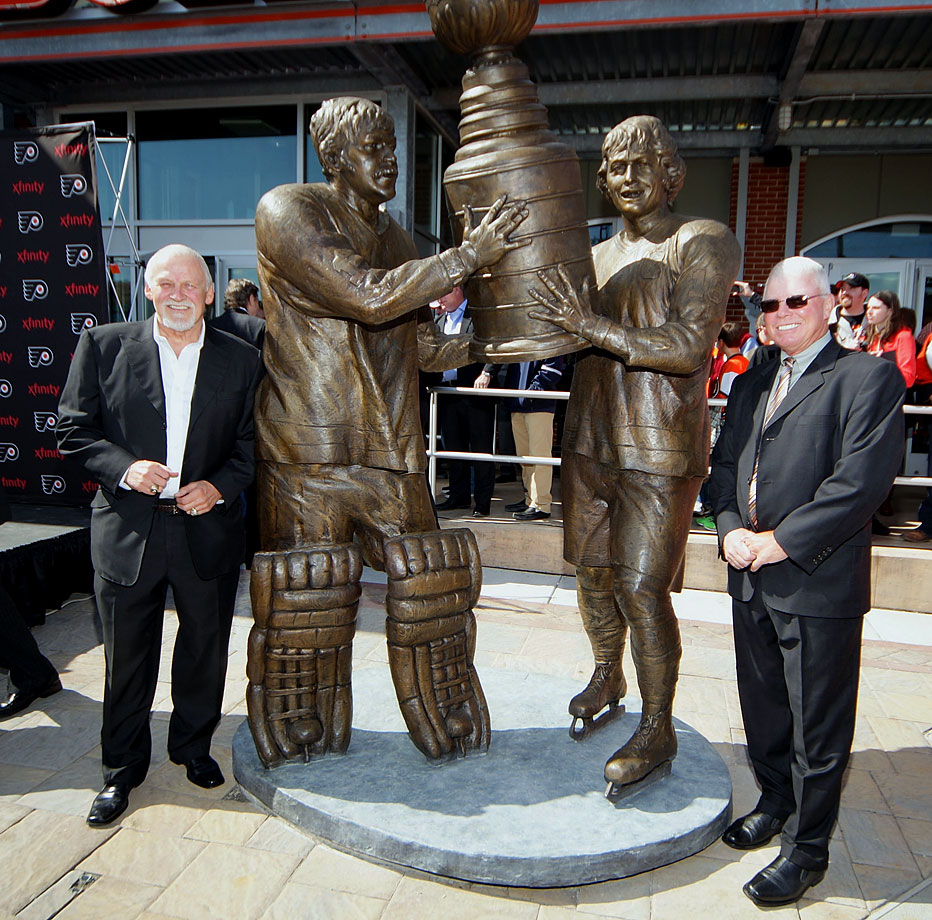 Bernie Parent and Bobby Clarke attend the unveiling of a new seven-foot tall bronze statue of them hoisting the Stanley Cup commemorating one of the most iconic moments in Philadelphia Flyers history at Xfinity Live on March 30, 2013 in Philadelphia.
