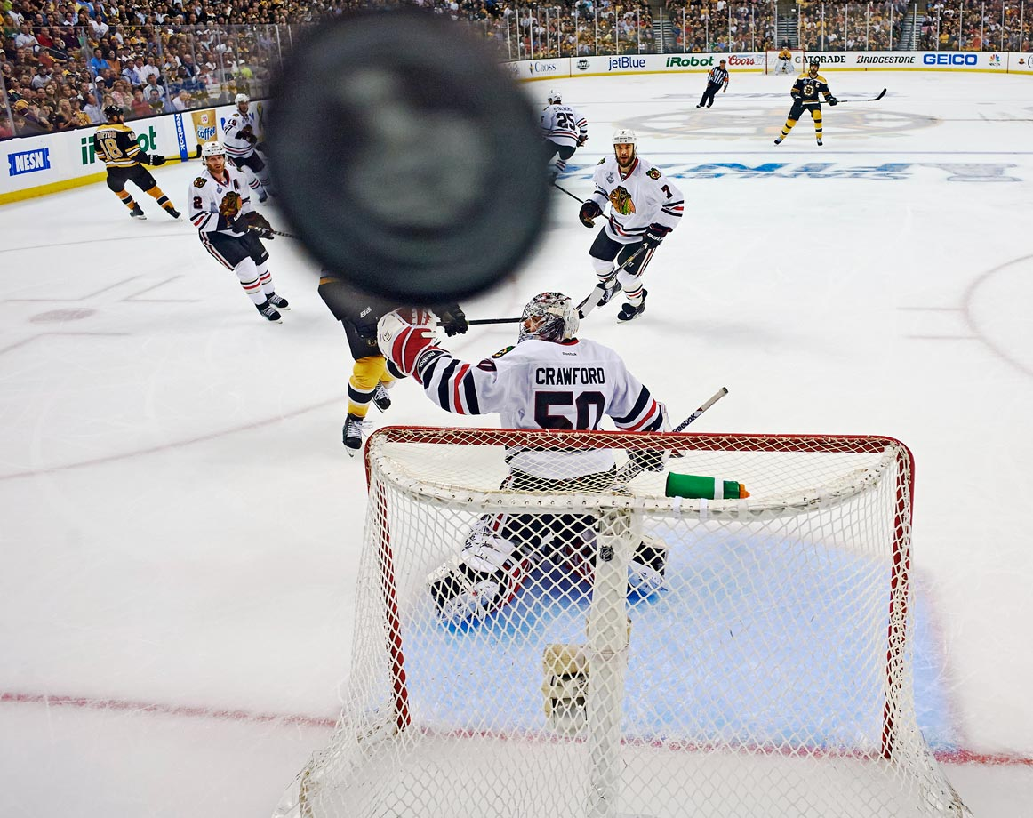 The hockey playoffs are when even the photo gear needs helmets. A puck obstructed one camera's view during Game 3 in Boston, which the Bruins won to take a 2-1 series lead over the Blackhawks. Chicago came back to win the next three games and the series.