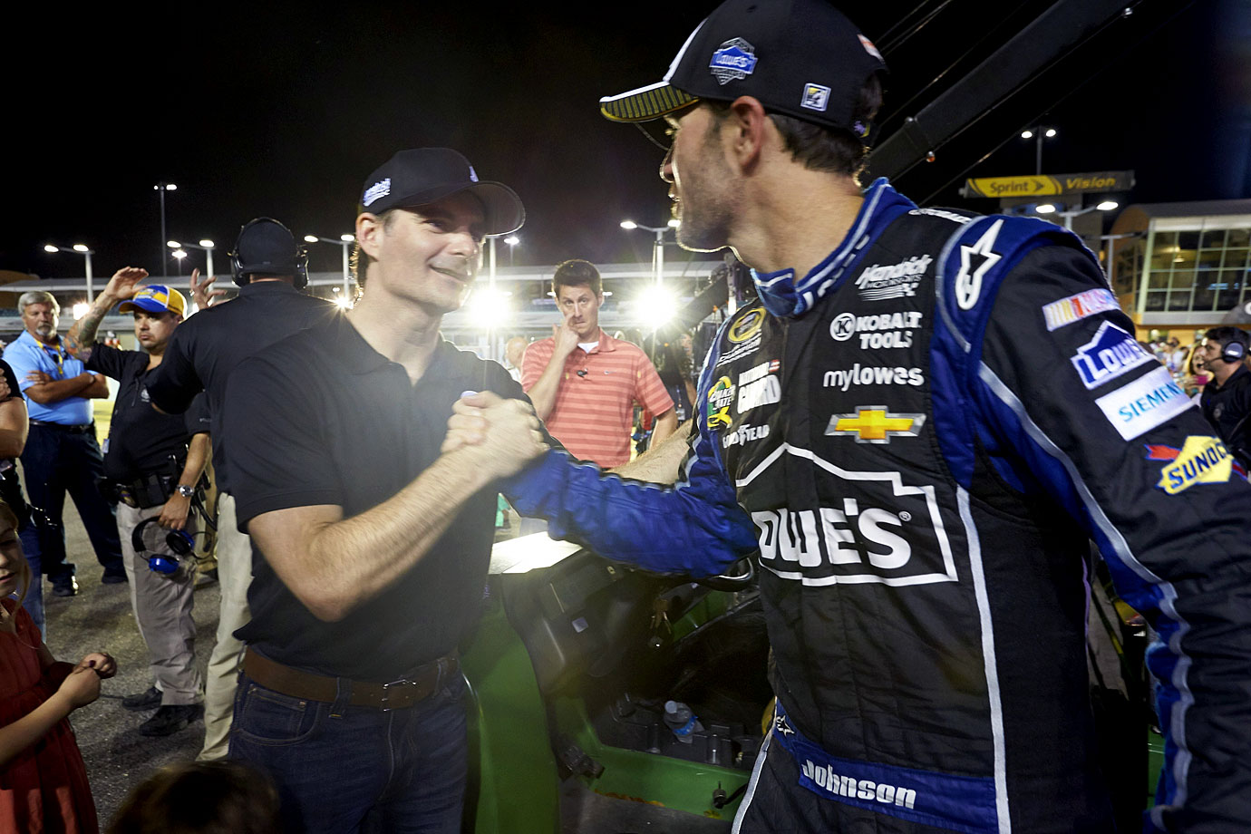 Jeff Gordon congratulates Jimmie Johnson on winning the Sprint Cup Series Championship at Homestead-Miami Speedway.