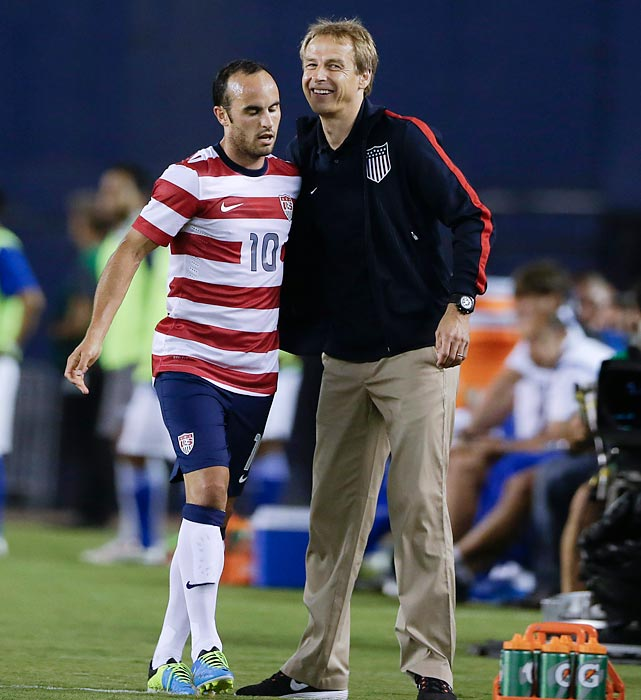 Longtime U.S. star Landon Donovan meets Klinsmann while exiting after scoring his second goal during a friendly against Guatemala in San Diego in 2013.