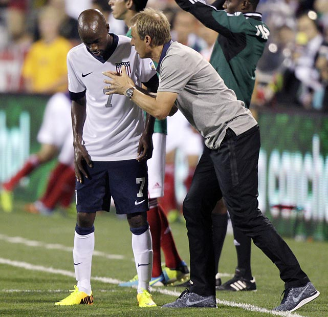 Veteran U.S. midfielder DaMarcus Beasley listens to Klinsmann during a World Cup qualifying match against Mexico in Columbus, Ohio in September 2013. The United States clinched its seventh straight World Cup appearance with second-half goals from Eddie Johnson and Landon Donovan in a 2-0 win.