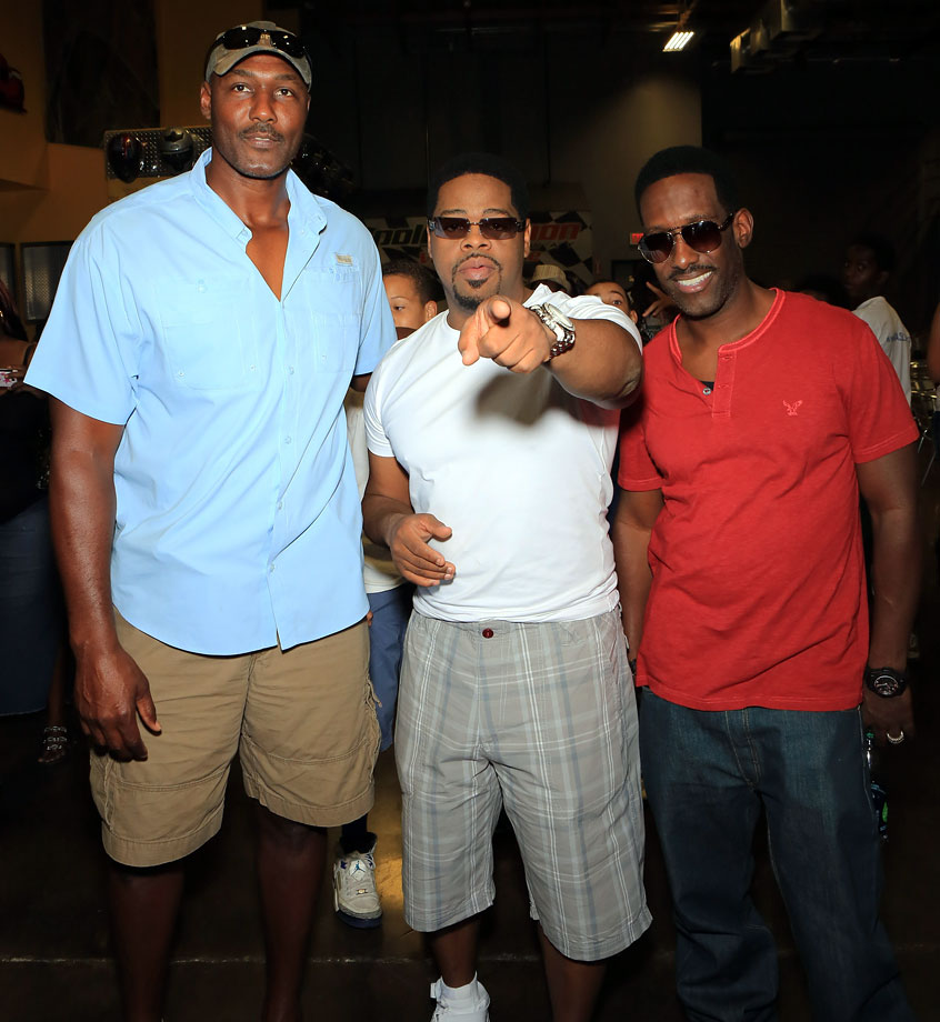 Karl Malone poses with Nathan Morris and Shawn Stockman of Boyz II Men at the group's charity event in Las Vegas.
