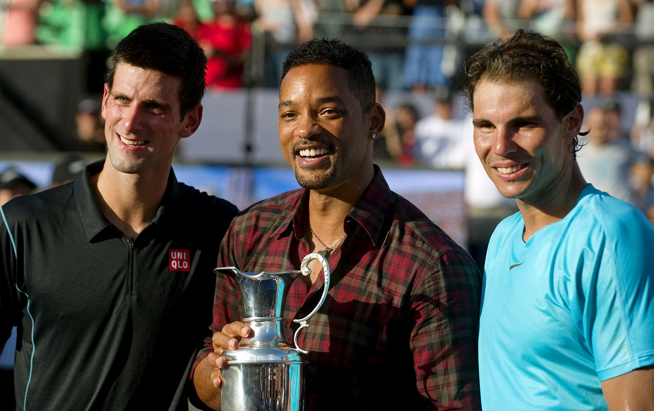 Novak Djokovic, Will Smith and Rafael Nadal pose with the trophy during an exhibition tennis match in Buenos Aires.
