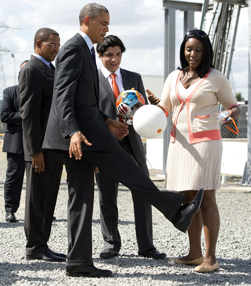 "Barack Obama plays with a ""soccket"" ball, a soccer ball that captures the energy during game play to charge LEDs and small batteries, alongside Tanzanian President Jakaya Kikwete (left) during a demonstration in 2013 at the Ubungo Plaza Symbion Power Plant in Dar Es Salaam, Tanzania."