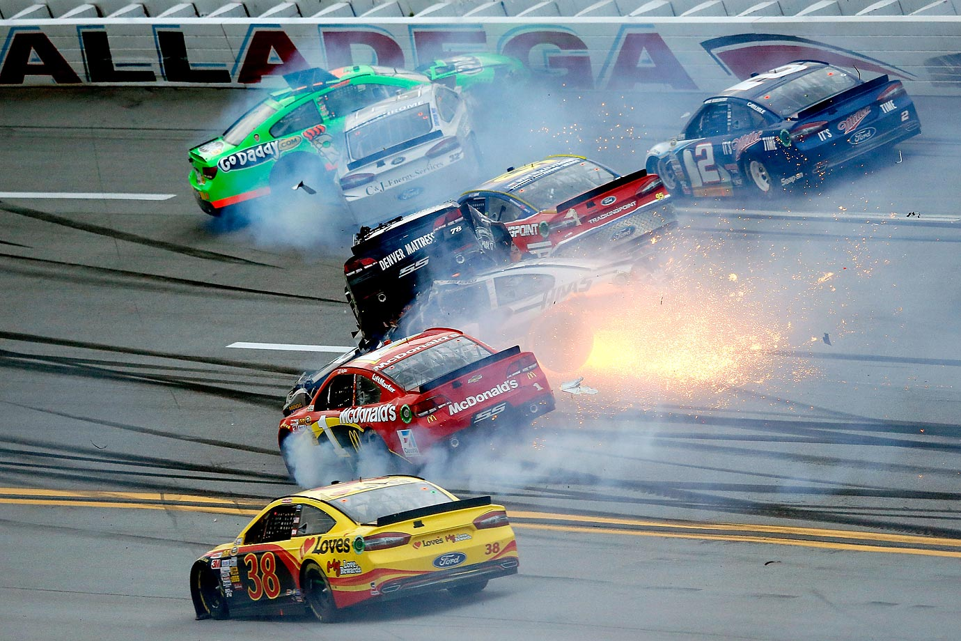 The leaders were running in a large pack heading into Turn 1 when Kyle Busch, charging up through the middle groove, hit the rear of Kasey Kahne's No. 5 car. The contact turned Kahne into the outside wall and set-off a chain reaction that involved 16 cars. Was a 16-car pileup. Later Kurt Busch was involved in a large wreck going into turn three in the final laps of the race that involved  12 cars.