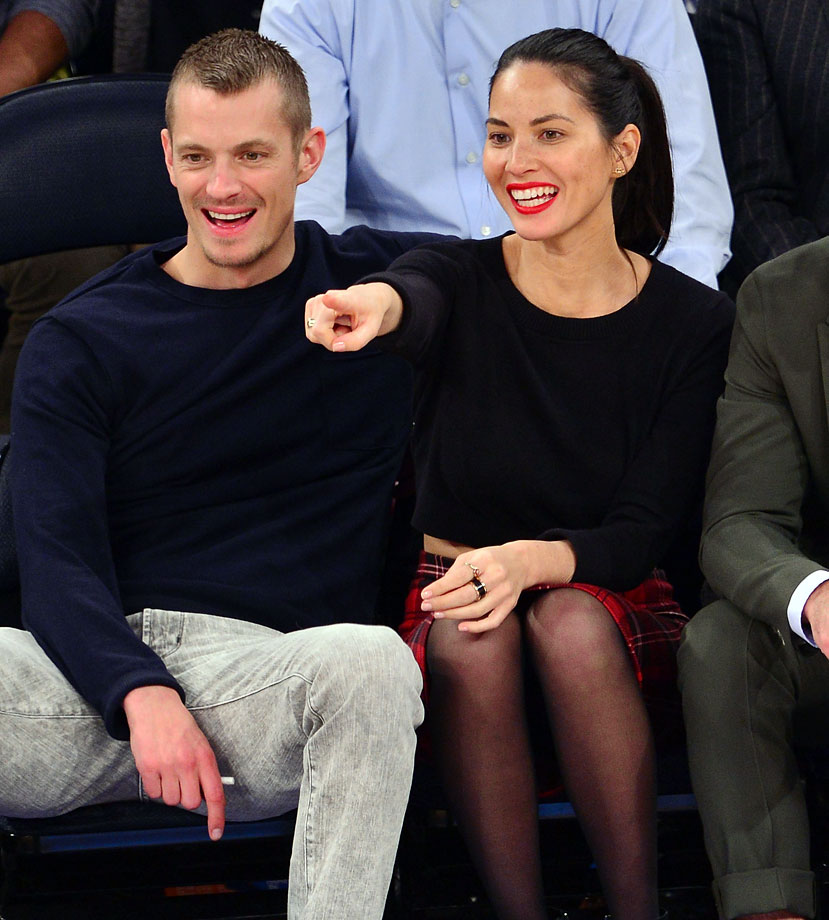 Joel Kinnaman and Olivia Munn attend the New York Knicks game against the Sacramento Kings at Madison Square Garden on Feb. 12, 2014 in New York City.